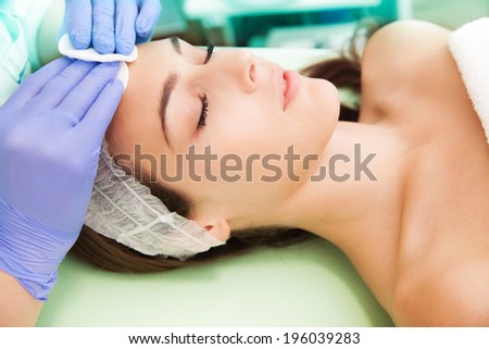 woman at facial cosmetics treatment - stock photo