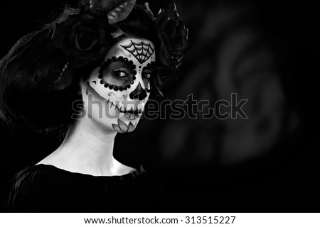 Woman at halloween wearing santa muerte mask, black and white photo. - stock photo