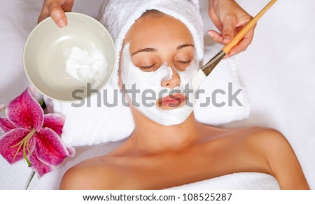 woman at spa having relaxing face mask - stock photo