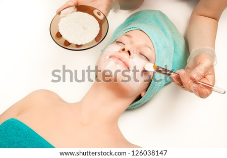 Woman at spa procedures applying mask - stock photo