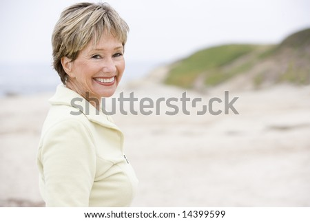 Woman at the beach smiling - stock photo