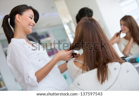 Woman at the hair salon getting a haircut - beauty concepts - stock photo