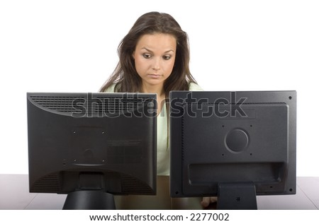 woman at the two lcd screens - looks worry - stock photo