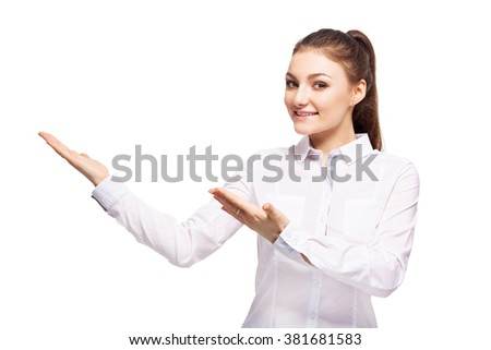 Woman at white background. Young female showing away - stock photo