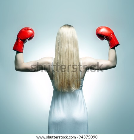 Woman back in white dress with red boxing gloves. Boxer bride - stock photo
