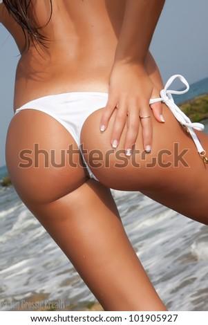 woman back with colorful bikini on beach - stock photo