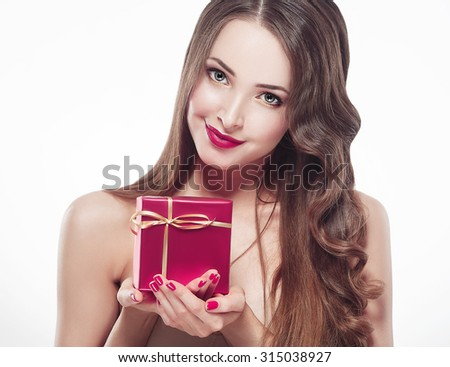 Woman beautiful portrait with gift box New year isolated on white  - stock photo