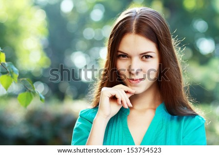 Woman. Beautiful young woman smiling thinking. Gorgeous fresh  female model in her 18s outdoor in the park - stock photo