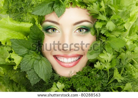 woman beauty face with greens vegetables frame - stock photo
