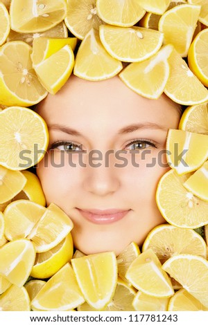 woman beauty face with lemons - stock photo