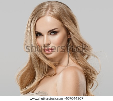 Woman beauty skin care close up portrait blonde hair studio on gray - stock photo