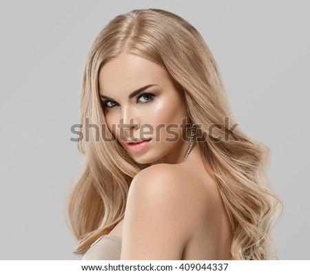 Woman beauty skin care close up portrait blonde hair studio on gray - stock photo