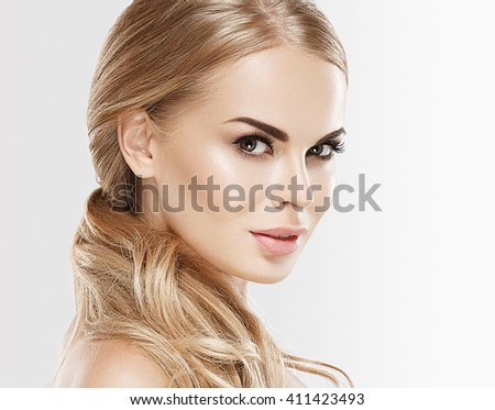 Woman beauty skin care close up portrait blonde hair studio on white - stock photo
