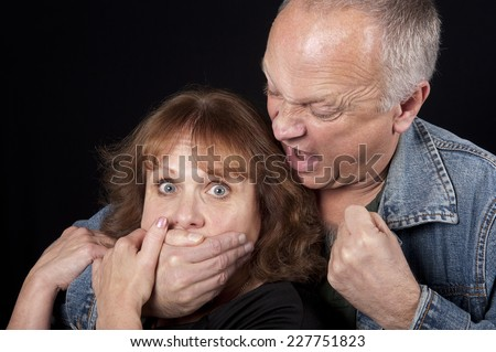 Woman Being Kidnapped - stock photo