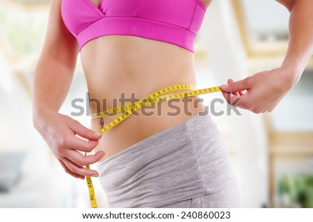woman belly measure - stock photo