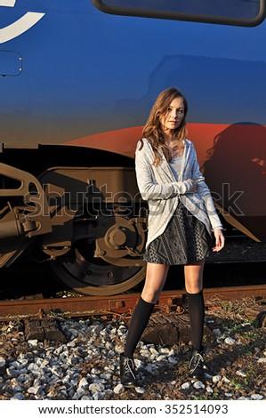Woman beside train  - stock photo