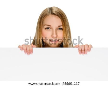 woman billboard. Young beautiful woman showing blank white placard. - stock photo