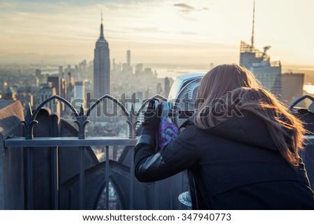 woman binocular new york - stock photo