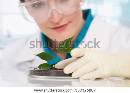 woman biologist with plants - stock photo
