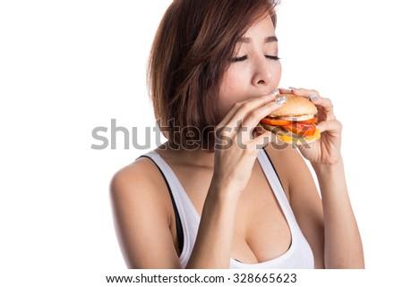 Woman biting and eating hamburger on white background - stock photo