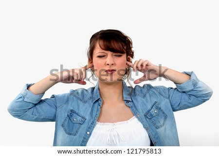 Woman blocking her ears - stock photo