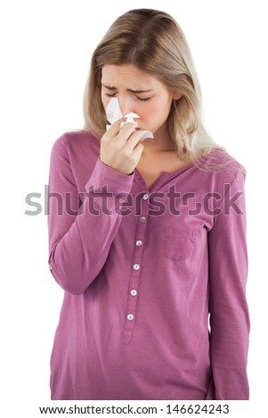 Woman blowing her nose on a white background - stock photo