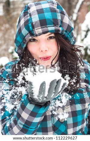 Woman blowing snow in my face - stock photo