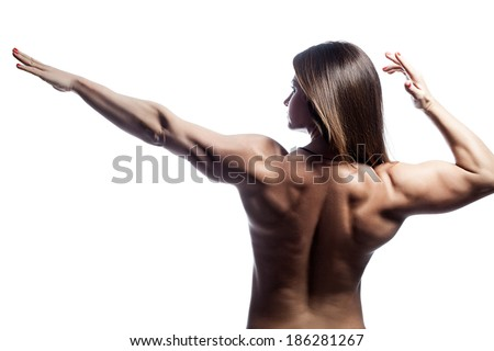Woman bodybuilder showing his muscles on his back. - stock photo