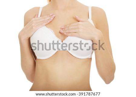 Woman breast in white bra. - stock photo