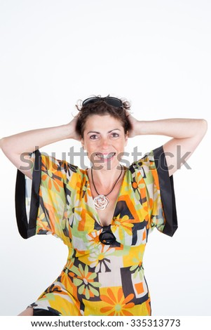 Woman, brunette with curly hair  looking at the camera - stock photo