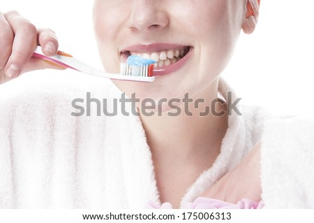Woman  brushing her teeth - isolated on white background. - stock photo