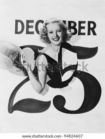 Woman bursting through calendar on Christmas day - stock photo