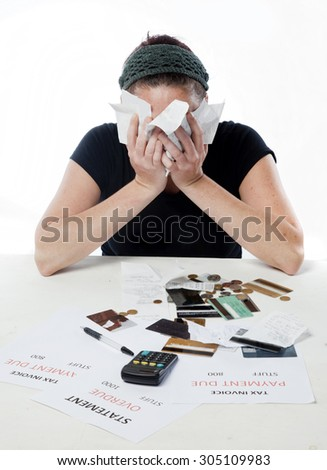 Woman burying her face in her problems.  - stock photo