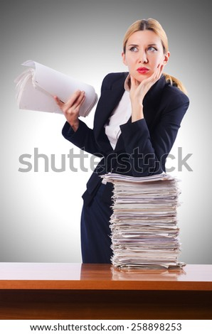 Woman businesswoman with lots of papers - stock photo
