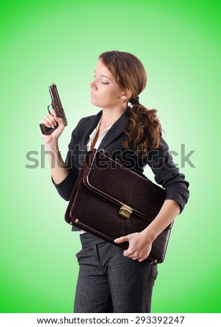 Woman businewoman with hand gun - stock photo