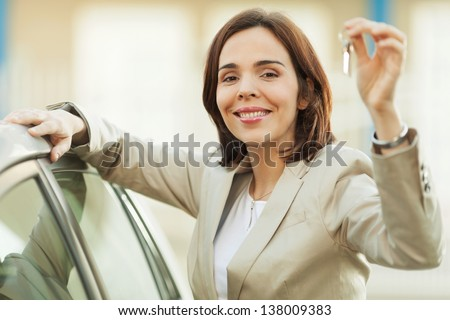Woman buying a car - stock photo