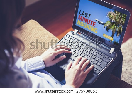 Woman buying a Last Minute Flight on the laptop. Germany flag design on the screen text. - stock photo