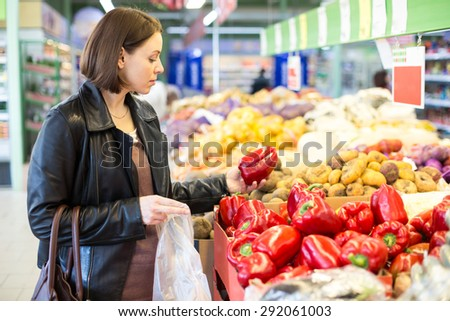 woman buys red pepper - stock photo