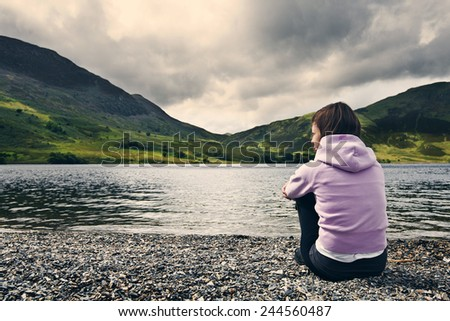 Woman by Crummock Water, Lake District. - stock photo
