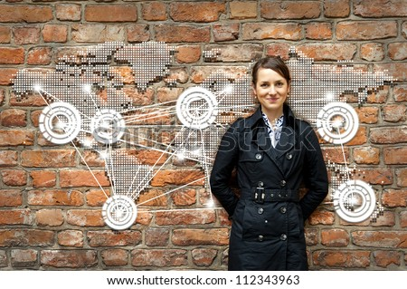Woman by the wall with world map travel - stock photo