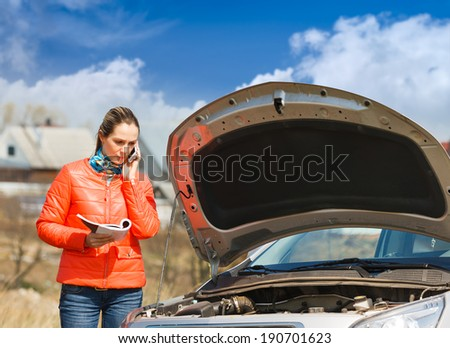 woman call for help broken car with the hood open - stock photo