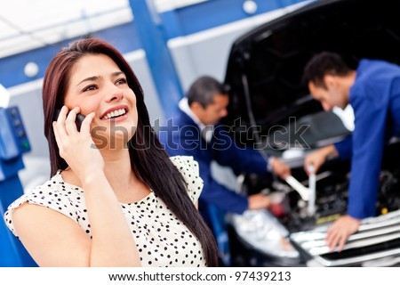 Woman calling mechanic after her car broke down - stock photo