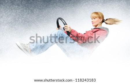 Woman car driver, concept of winter driving - stock photo