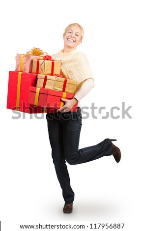 Woman carrying a lot of Christmas presents - stock photo