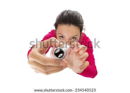 woman changing a light bulb shot from a birds eye  view looking down - stock photo