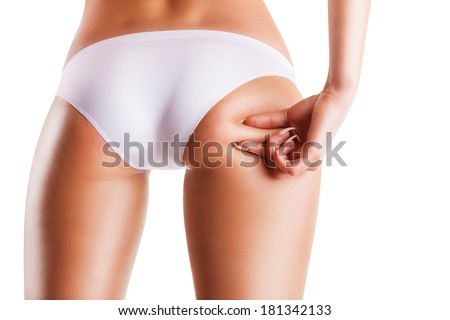 Woman checks for the presence of the skin of the buttocks cellulite - stock photo