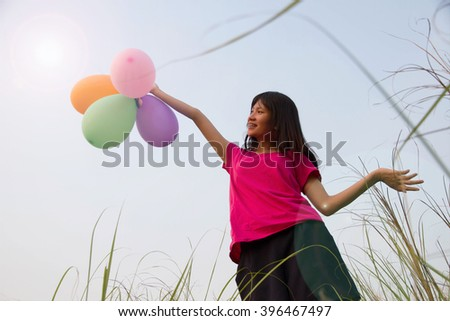 Woman cheerful  joy with balloon in the summertime  - stock photo