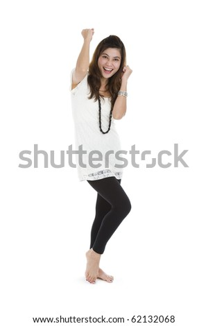 woman cheering and dancing with her fists in the air, isolated on white background - stock photo