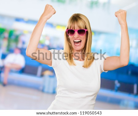 Woman Cheering at the airport - stock photo