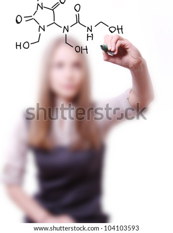 woman chemist shows a molecular structure - stock photo